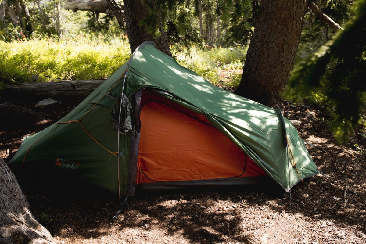 green tent pitched in proper campsite - beginner backppacking mistake 3